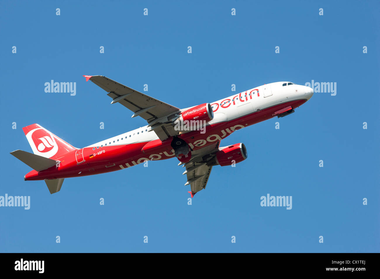 Passenger jet plane taking off from Düsseldorf International Airport. Air Berlin, Airbus A320-214, - Stock Image