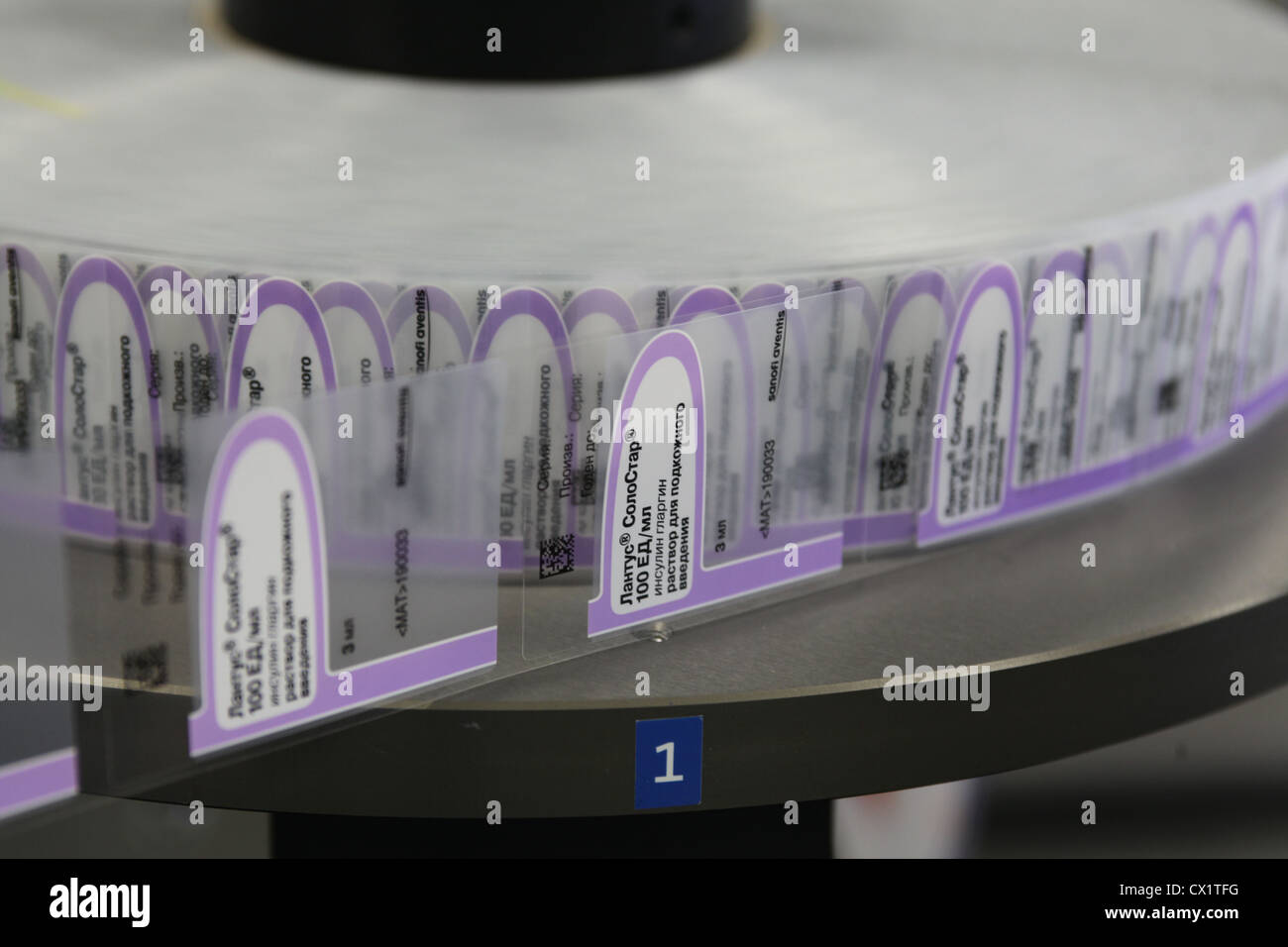 ITAR-TASS: ORYOL REGION, RUSSIA. MAY 24, 2011. Labeling machine on an assembly line for insulin glargine pens (brand - Stock Image