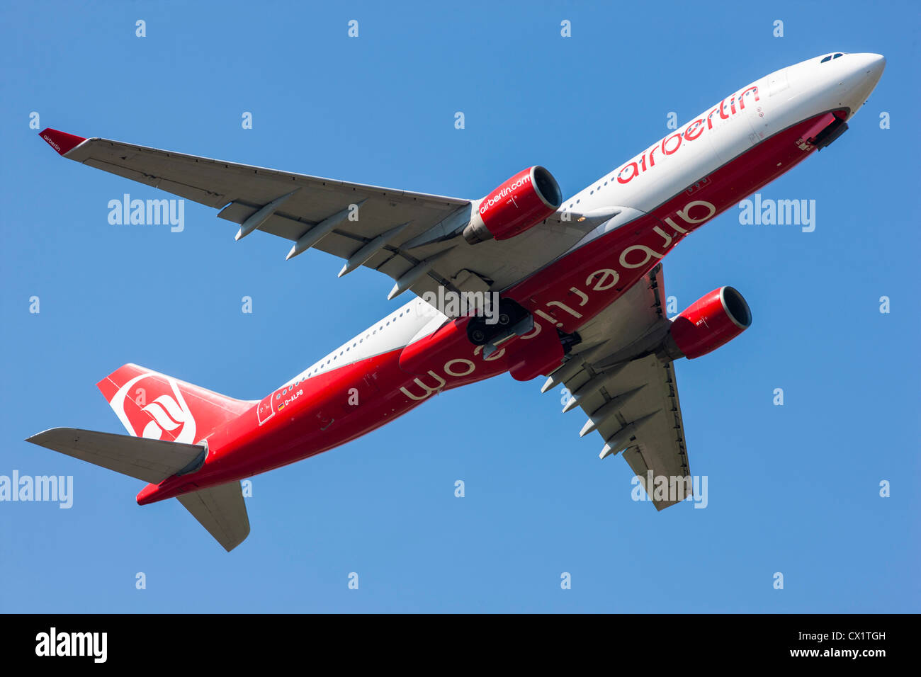 Passenger jet plane taking off from  Düsseldorf International Airport. Air Berlin, Airbus A330-223, - Stock Image