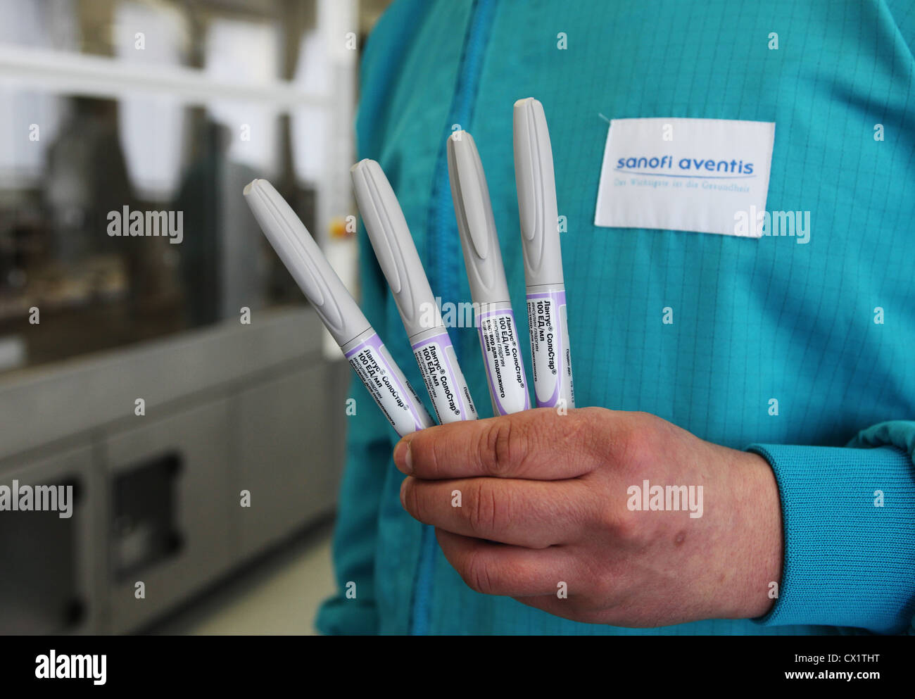 ITAR-TASS: ORYOL REGION, RUSSIA. MAY 24, 2011. A pharmaceutical worker holding insulin glargine pens (brand name - Stock Image