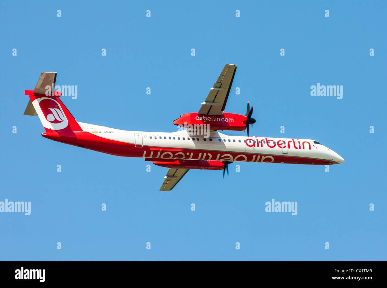 Passenger jet plane taking off from Düsseldorf International Airport. Air Berlin,  Bombardier DHC 8Q-400, - Stock Image