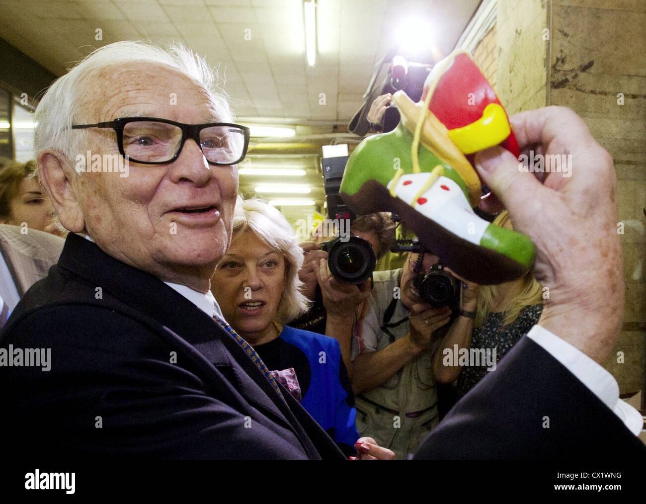ITAR-TASS: MOSCOW, RUSSIA. JUNE 7, 2011. French designer Pierre Cardin poses with a souvenir boot at Moscow's - Stock Image