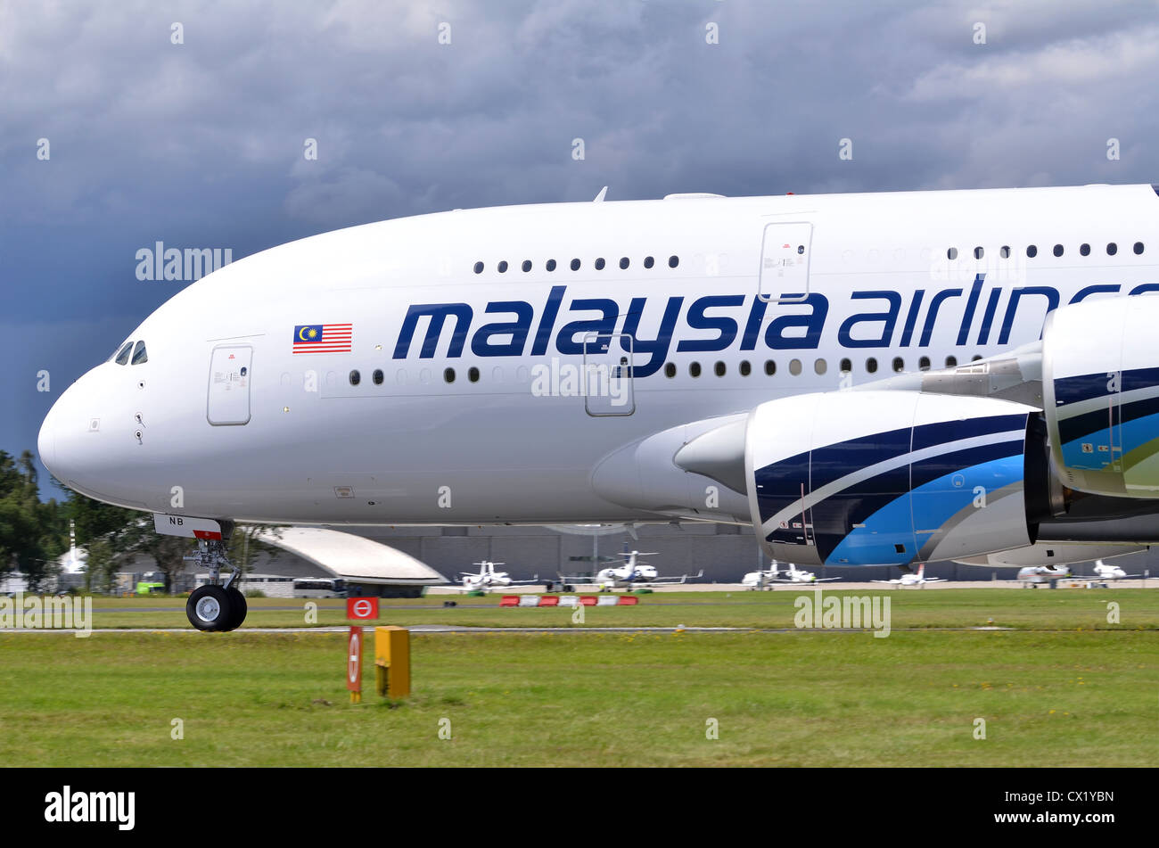 Airbus A380 in the colours of Malaysia Airlines rolling out after landing at Farnborough International Airshow 2012 - Stock Image