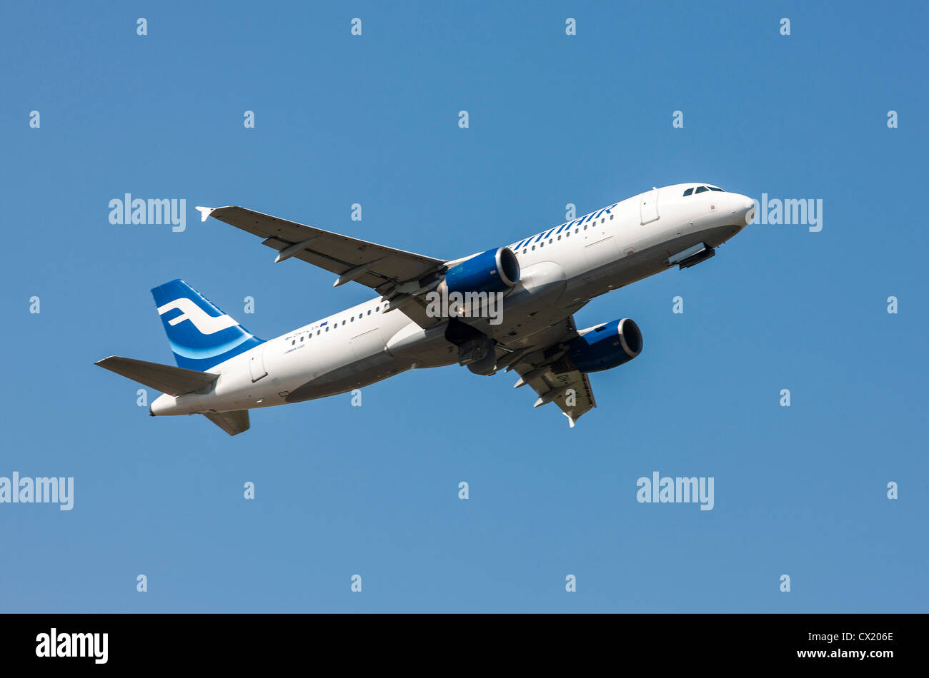 Passenger jet plane taking off form Düsseldorf International Airport. Finnair, Airbus A320, - Stock Image