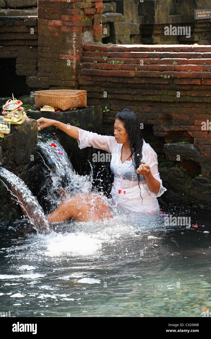A person receiving a blessing as part of purification ritual at the holy water pools. Pura Tirta Empul, or Holy - Stock Image