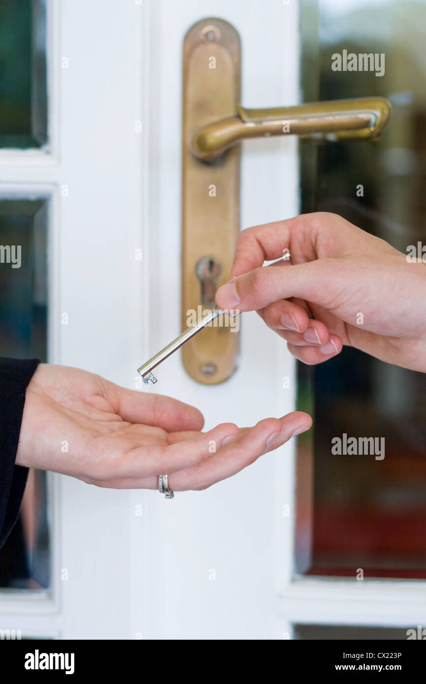 handing over the house key - Stock Image