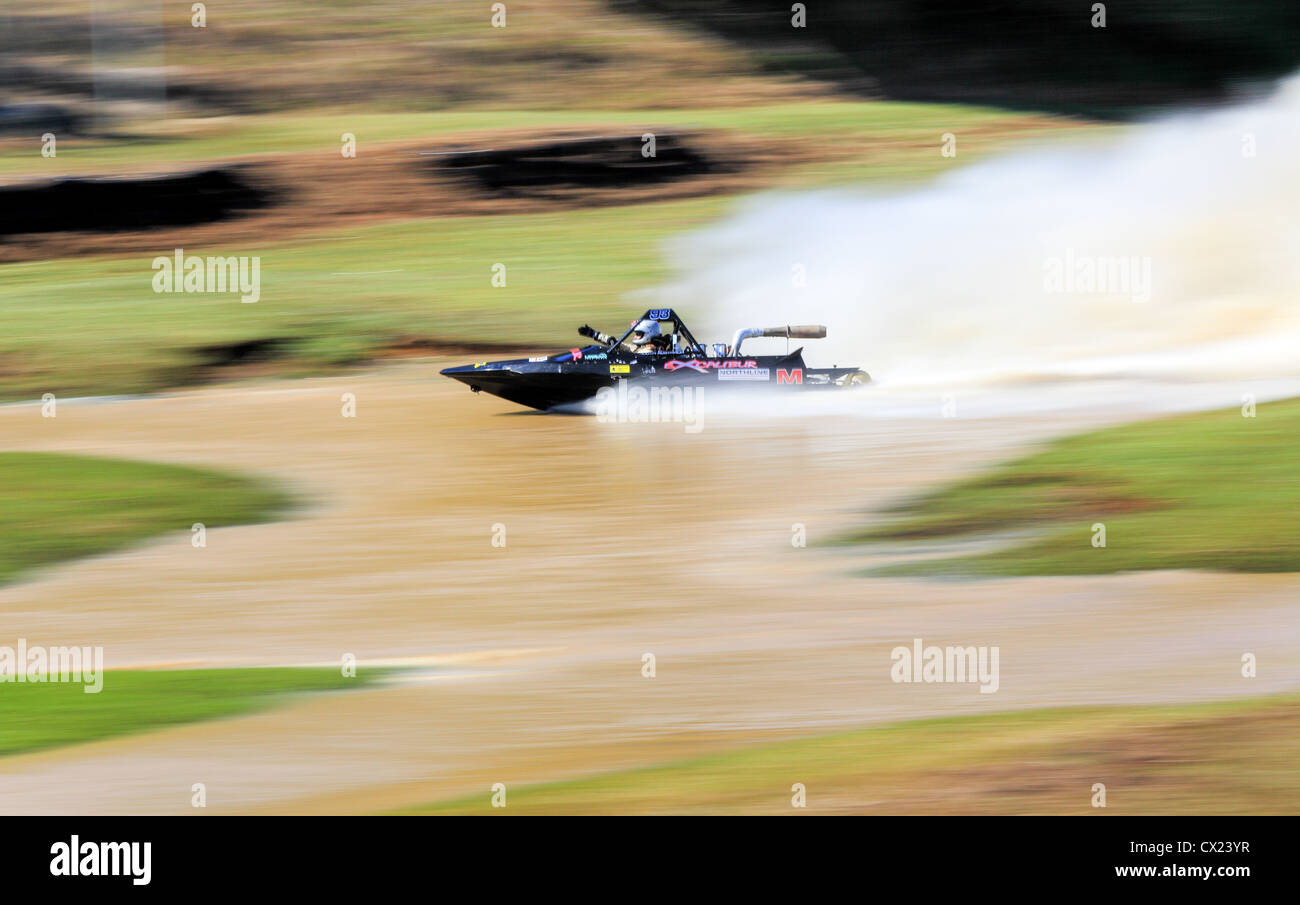 Motion blur of a boat at the Australian Jet Sprint Boat championship timed sprint runs on enclosed course Cabarita - Stock Image
