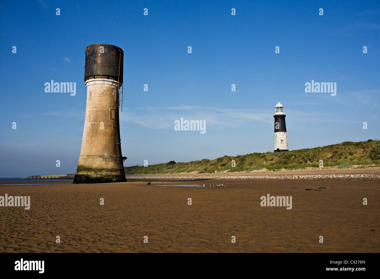 Portrait photo showing Spurn Lowlight and Spurn lighthouse from the perspective of the beach, facing the mainland. - Stock Image