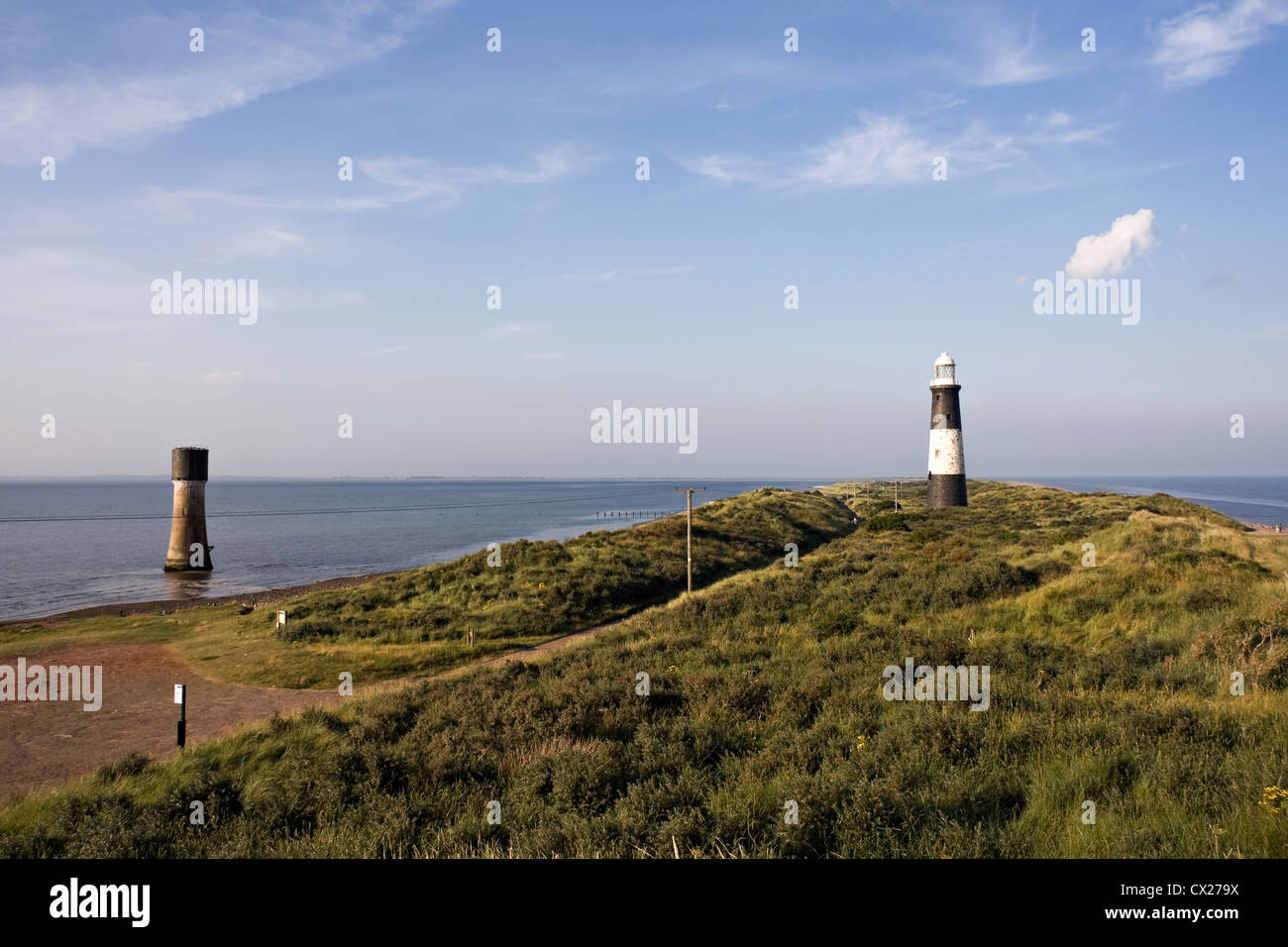 Landscape photograph of Spurn Lighthouse and Spurn Lowlight, showing the River Humber and the North Sea on a sunny - Stock Image