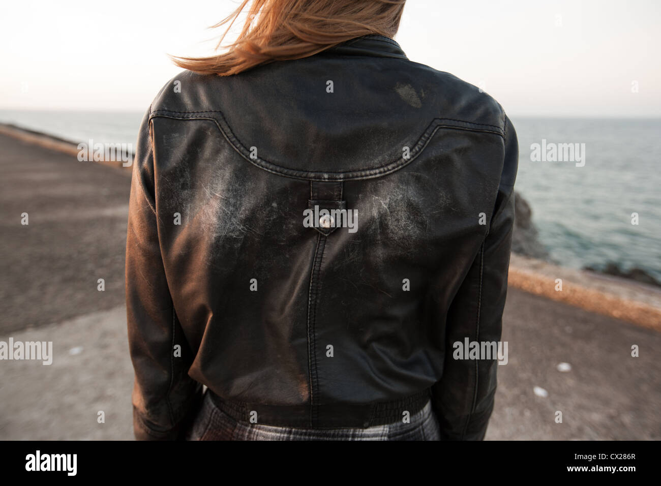 3ace0dc3928 Girl on pier with old worn leather jacket Stock Photo  50452159 - Alamy
