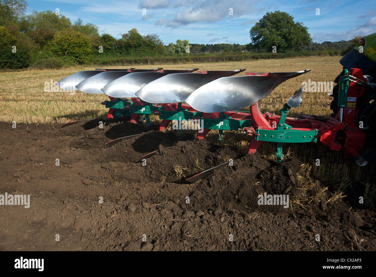 Ploughing a stubble field UK - Stock Image