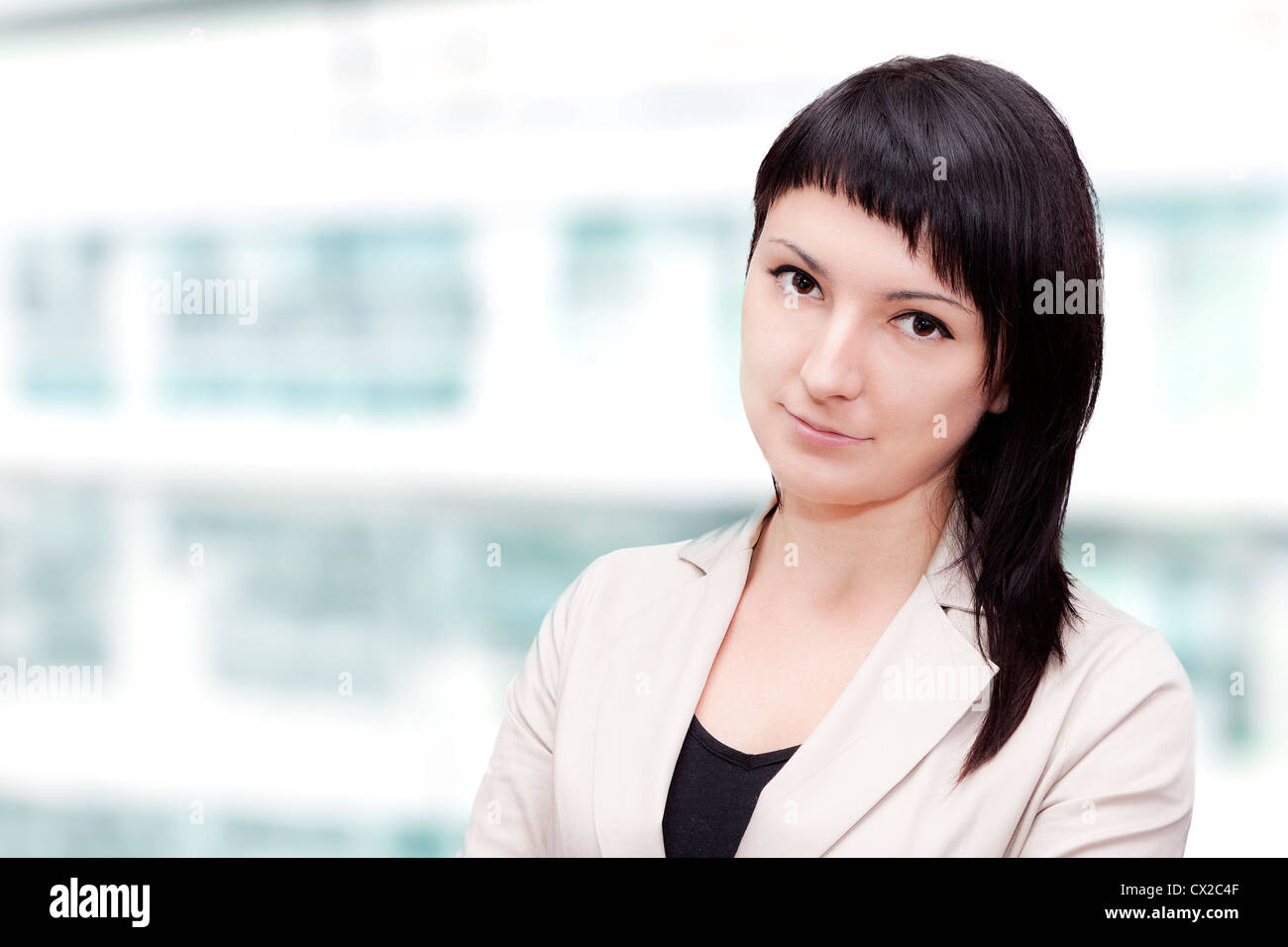 2bdaeb00fd4 clean modern portrait of a young professional business woman with ample  copyspace.