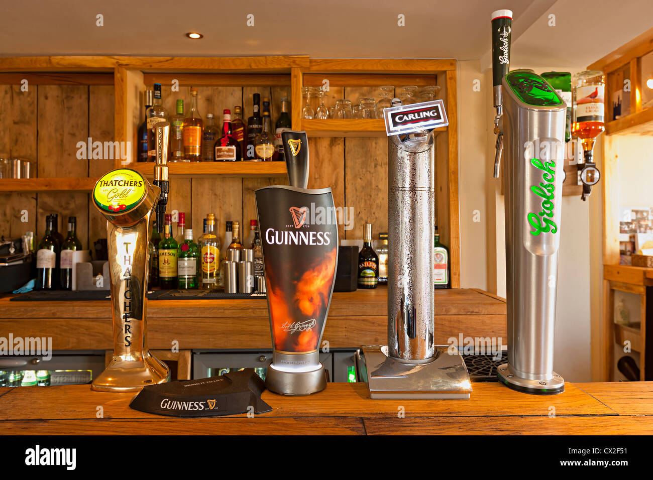 Genial Beer Pumps On A Bar At A Modern Country Pub