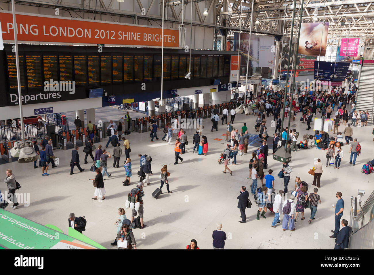 Waterloo Railway Station concourse and departure board - Stock Image