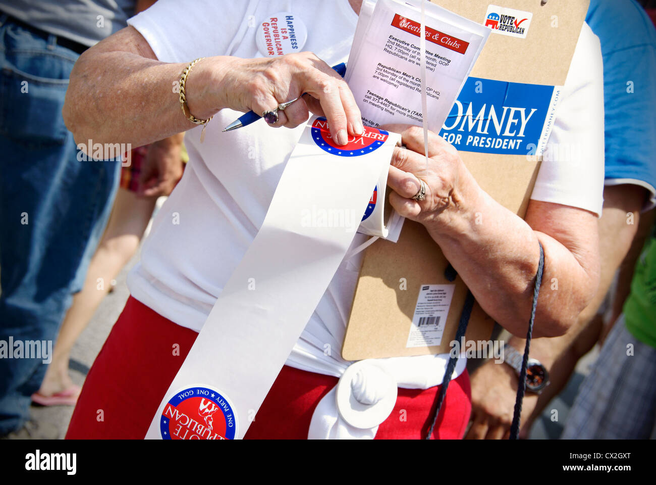 Republican woman promoting Mitt Romney and voter registrations at the 4th of July celebration in Greensboro, North - Stock Image
