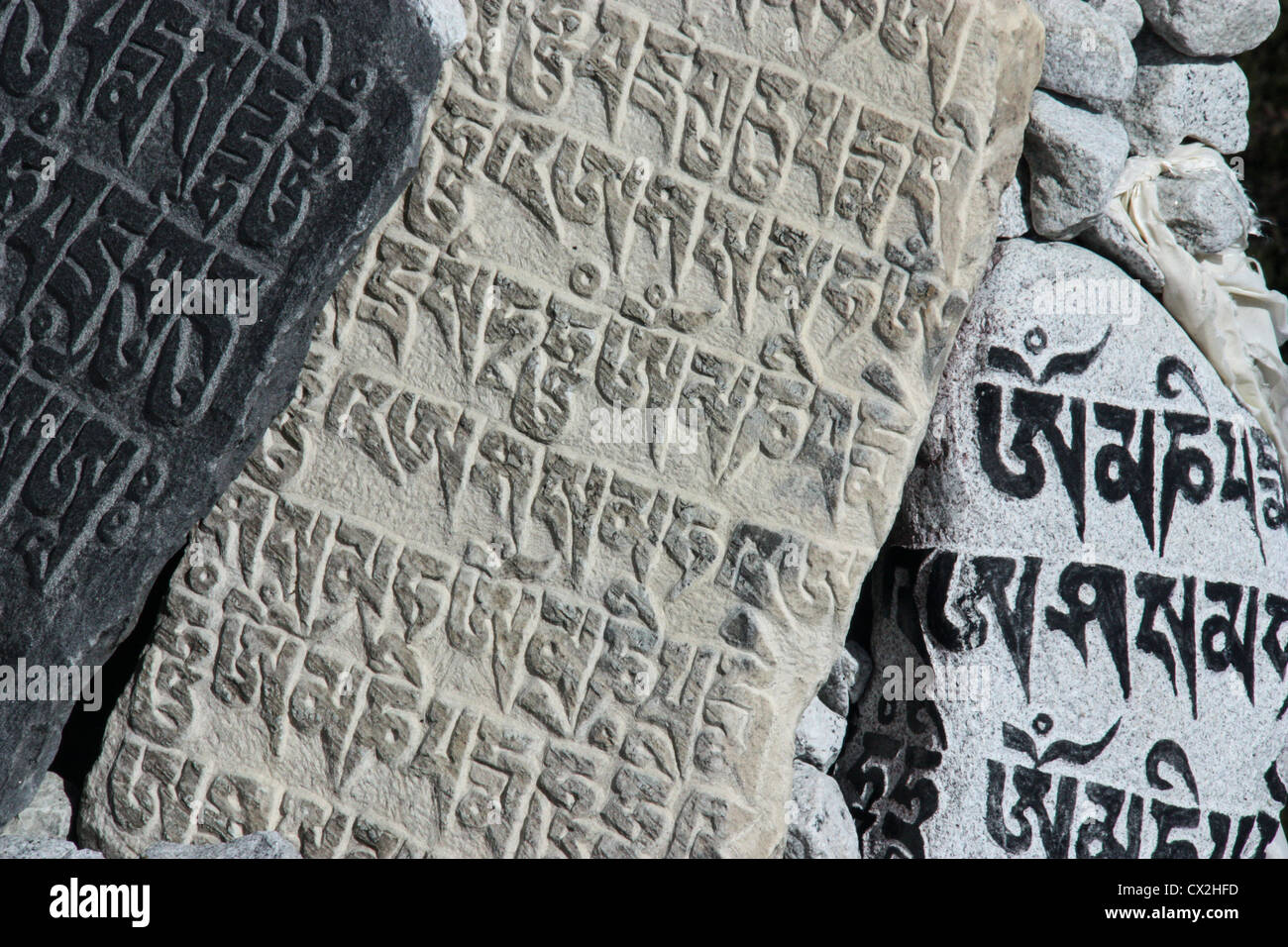 'Mani' stone, depicting Buddhist mantra 'Om Mani Padme Hum'- 'Hail to the jewel in the lotus, - Stock Image