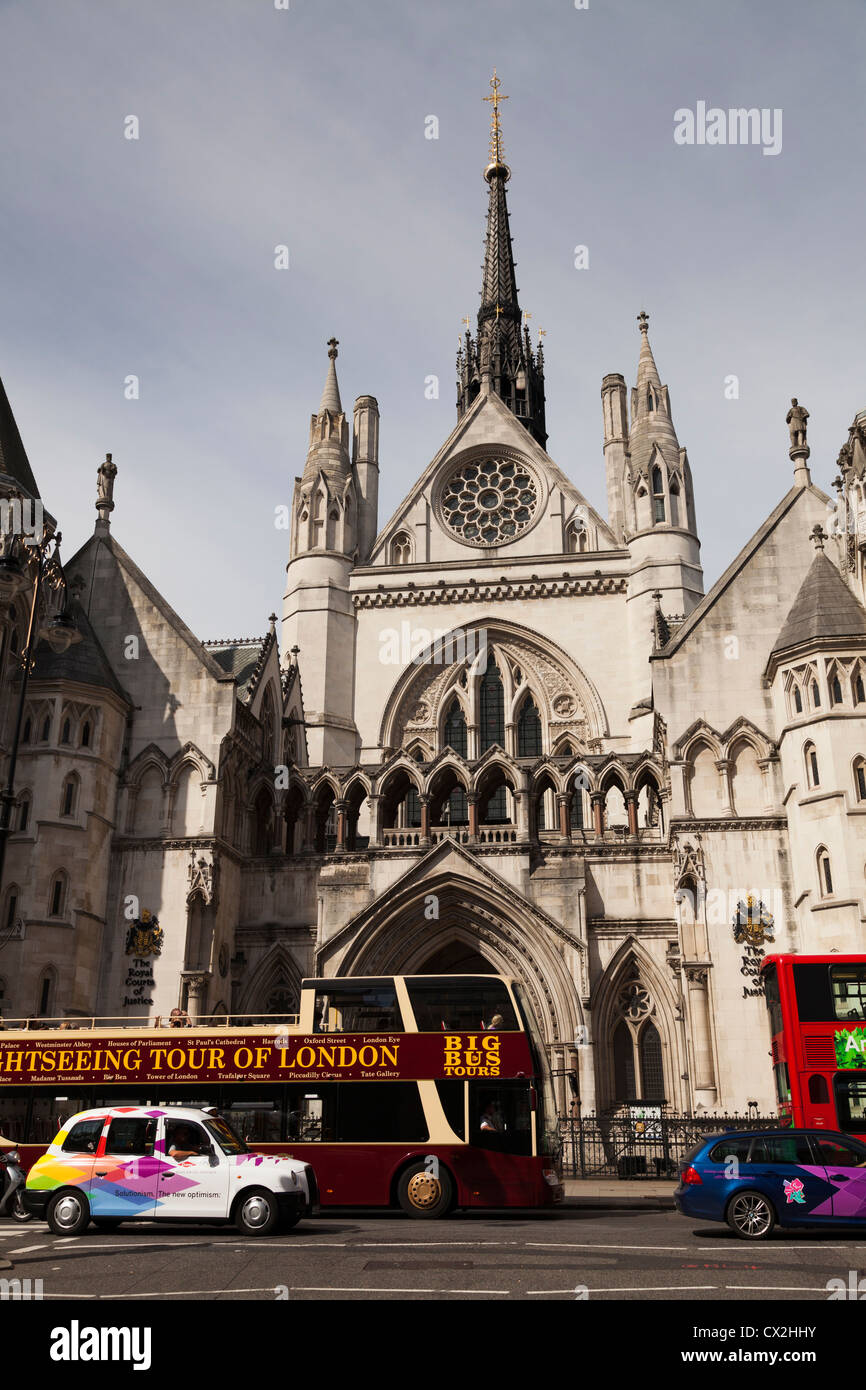 sightseeing  open topped bus and taxi outside the Royal Courts of Justice in Fleet Street London Stock Photo