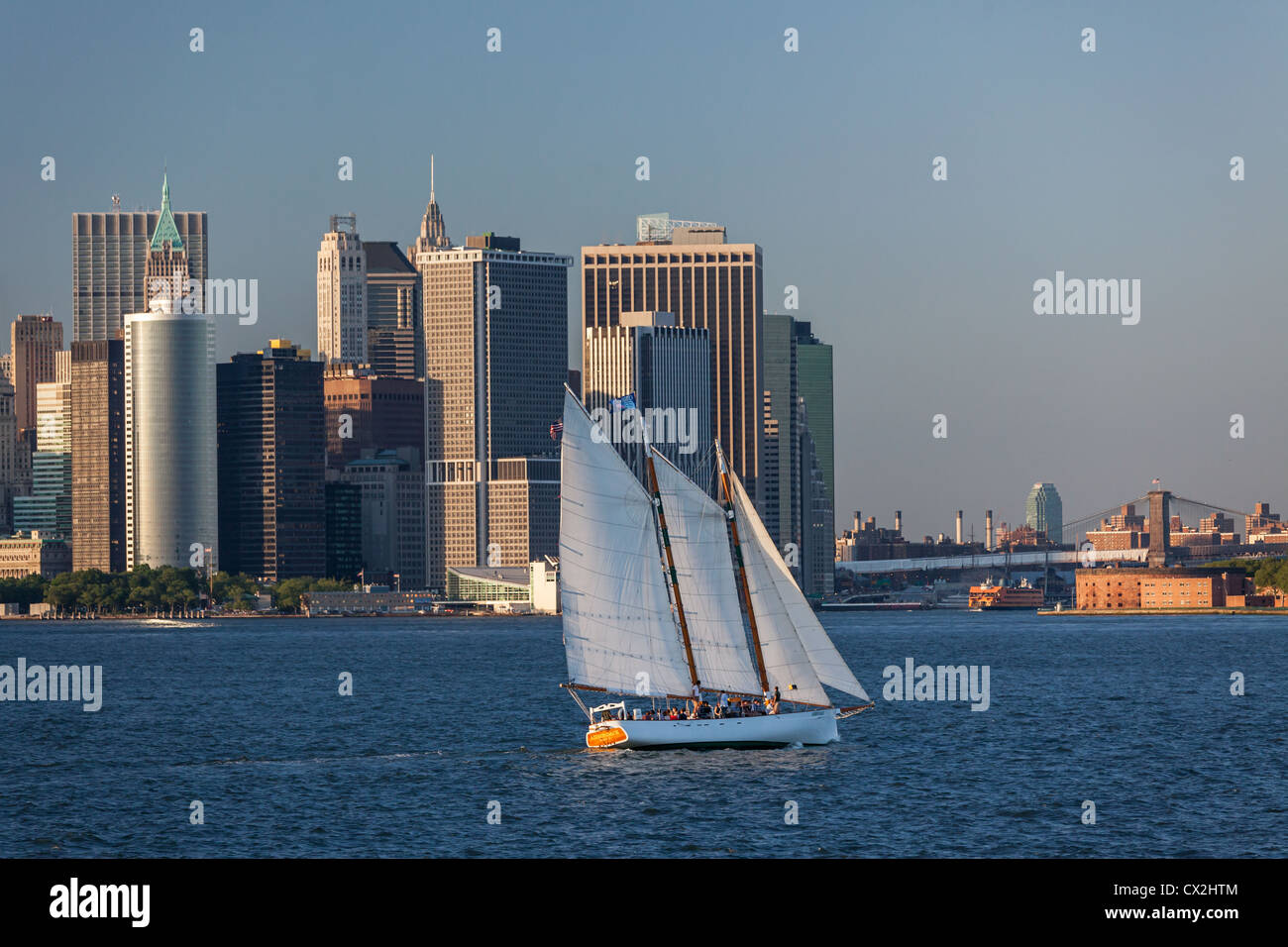 Lower Manhattan Skyline, Sailing Boat, East River,  New York - Stock Image
