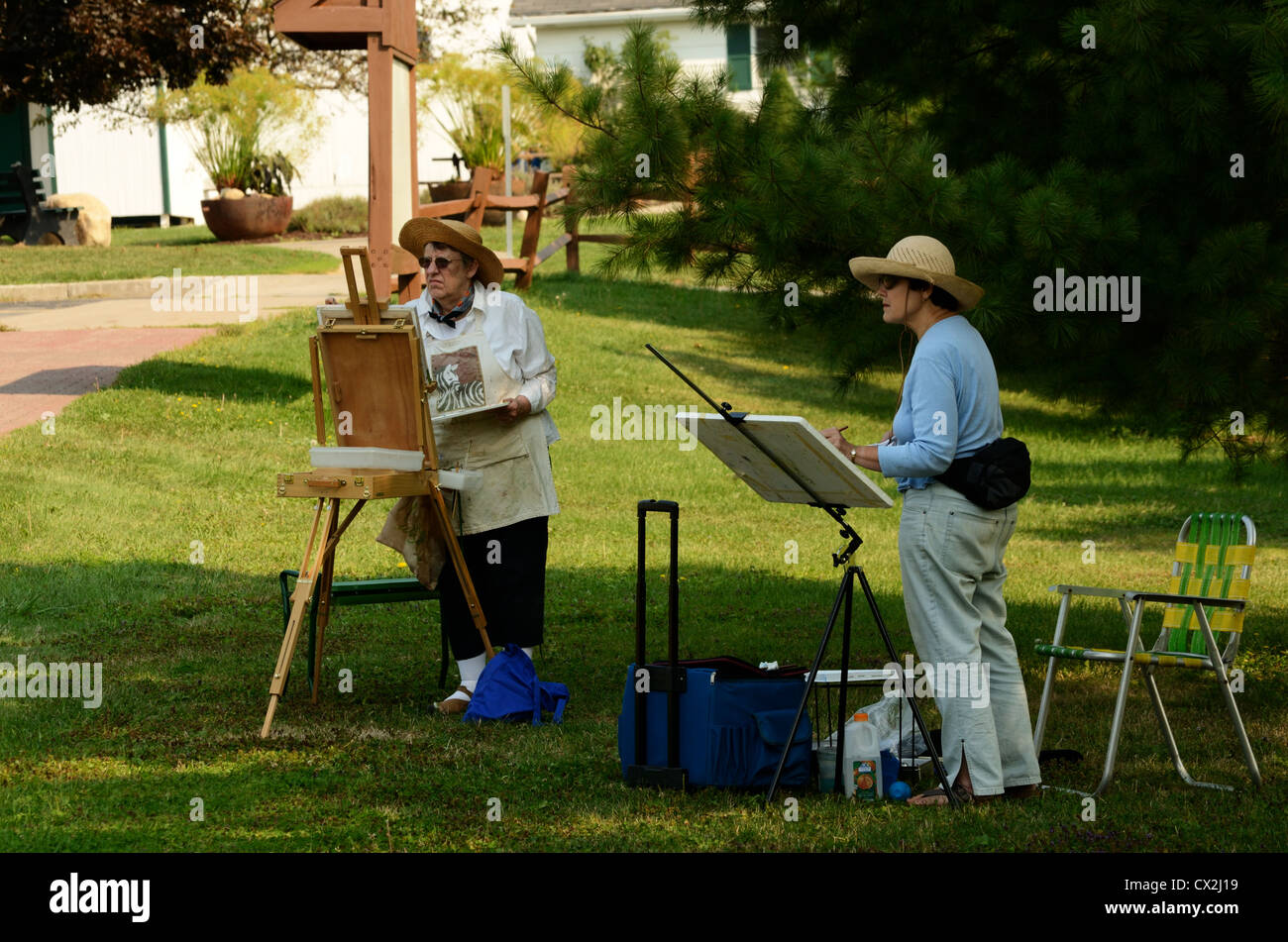 Plein Aire artists painting out doors. - Stock Image