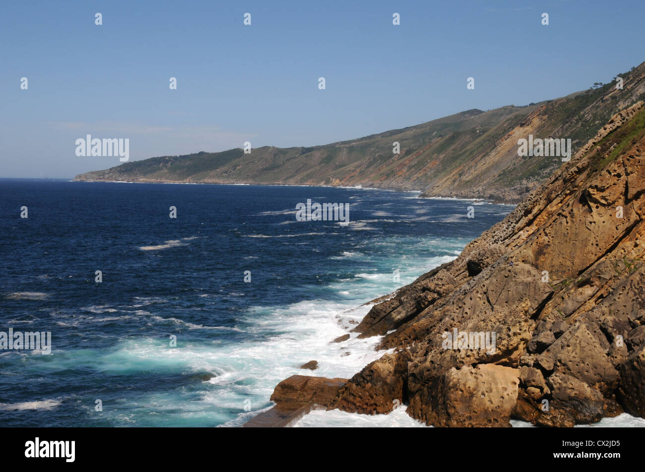 Coastline by the entrance to the port of the north Spanish town of Pasajes - Stock Image