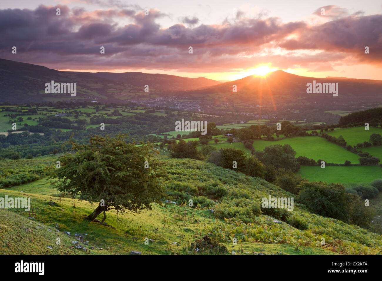 Sunrise over the Sugarloaf and town of Crickhowell, Brecon Beacons National Park, Powys, Wales. Summer (August) - Stock Image