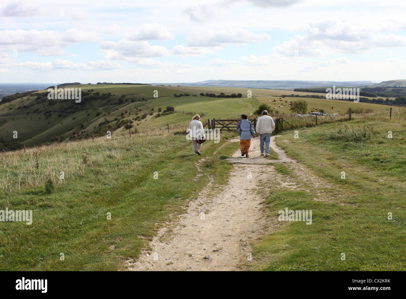 Walkers on a chalk footpath at Ditchling Beacon, East Sussex - Stock Image