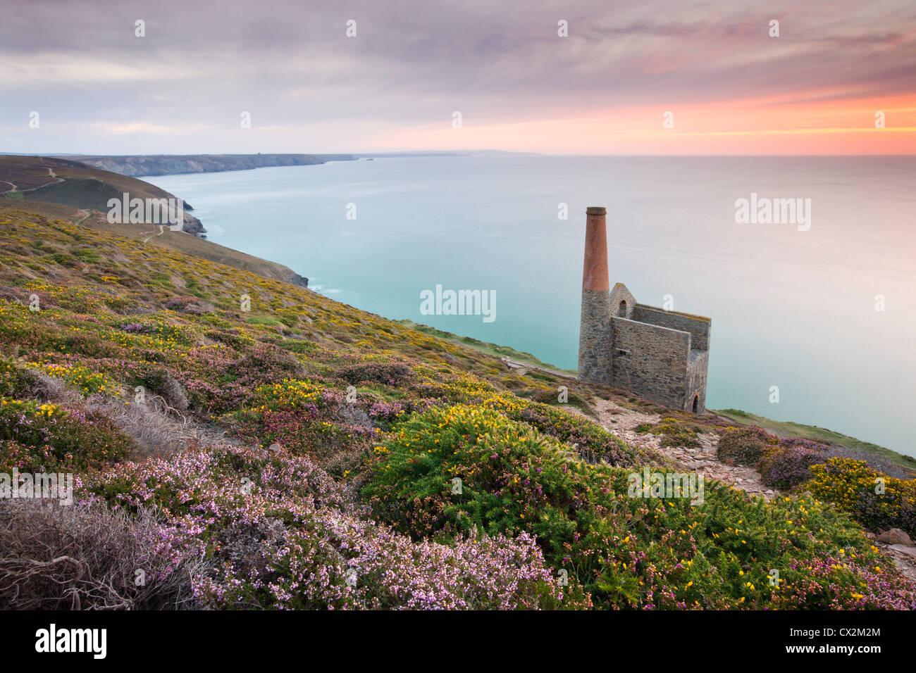 Sunset behind Towanroath Engine House, part of Wheal Coates Tin Mine on the Cornish coast near St Agnes, Cornwall, - Stock Image