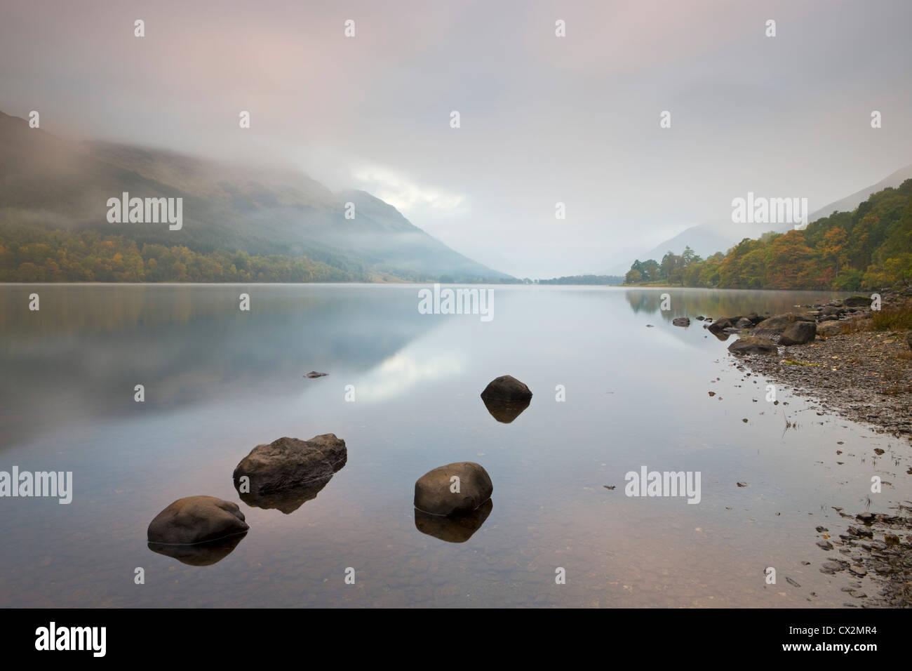 Loch Voil shrouded in mist at dawn, Balquhidder, Loch Lomond and The Trossachs, Scotland - Stock Image