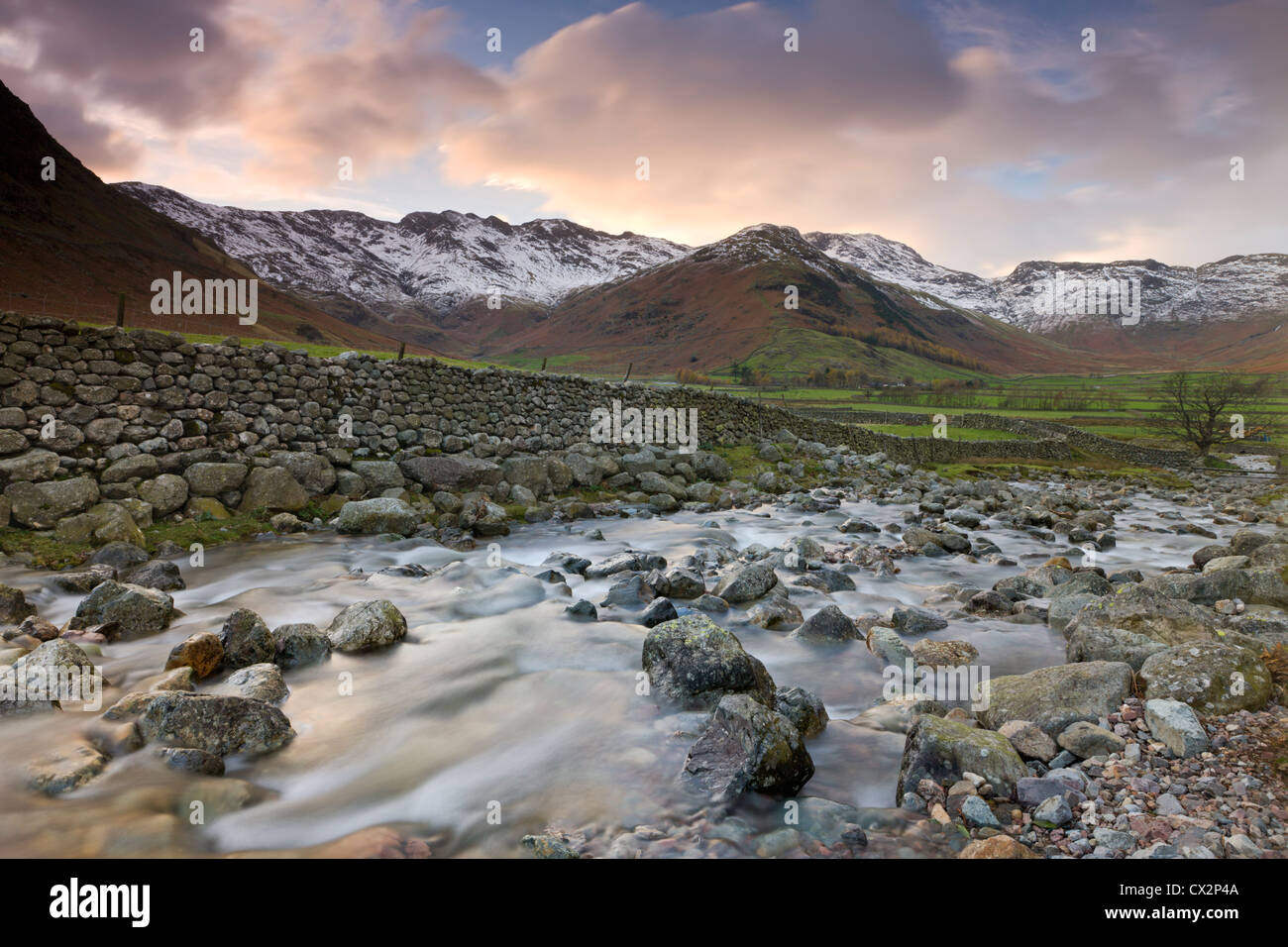 Redacre Gill tumbling down a rocky hillside in the Great Langdale Valley, Lake District National Park - Stock Image