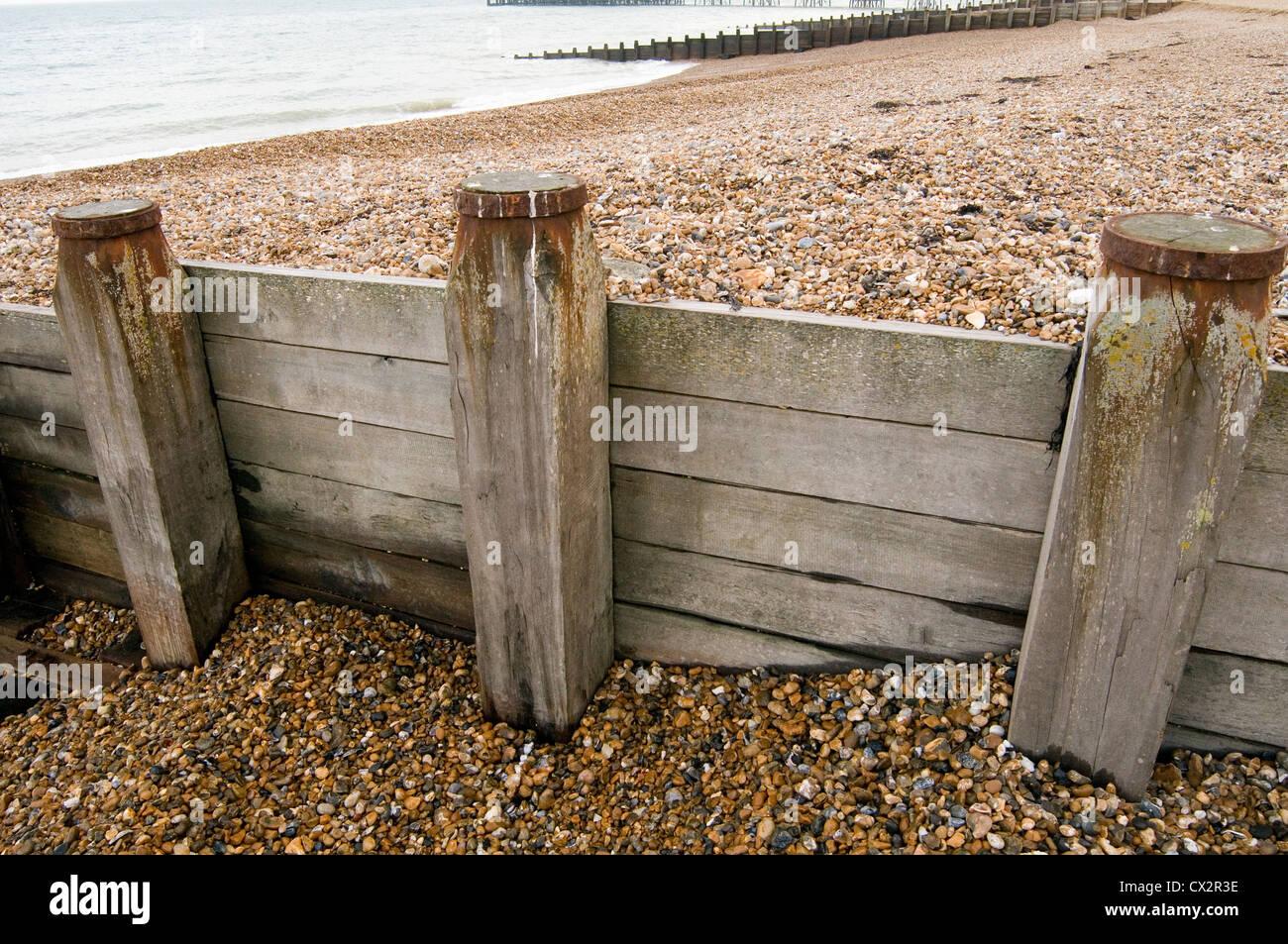 breakwaters breakwater break water waters sea seas coastal erosion wood timber beach beaches eastbourne sussex - Stock Image
