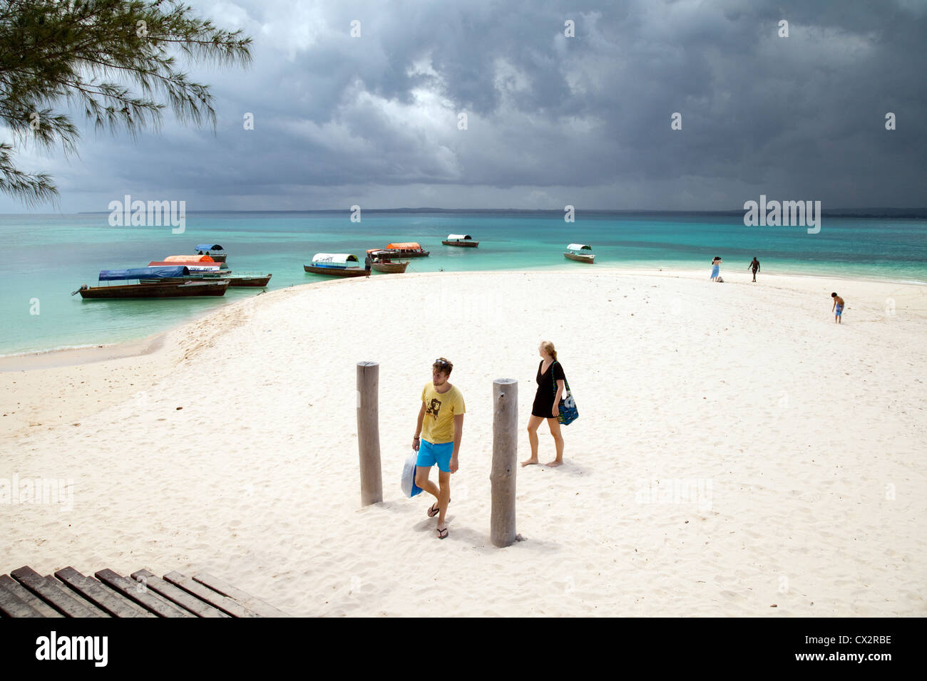 Tourists arriving on the beach, Prison Island, Zanzibar Africa - Stock Image
