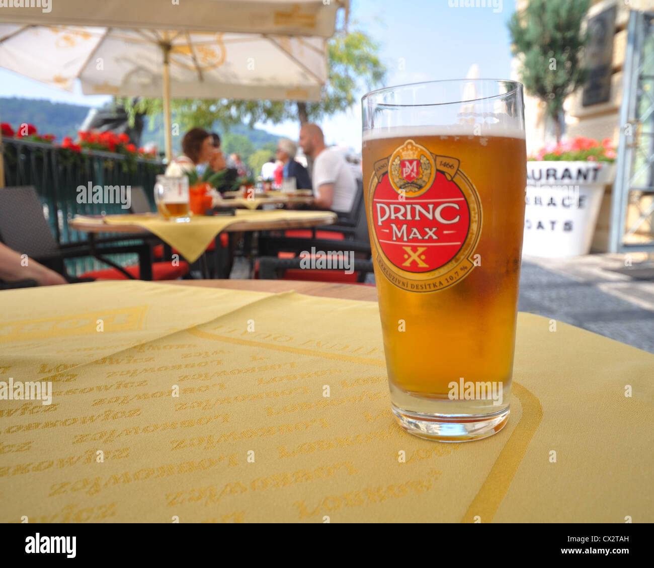 Glass of beer on a restaurant table, Prague, Czech Republic. - Stock Image
