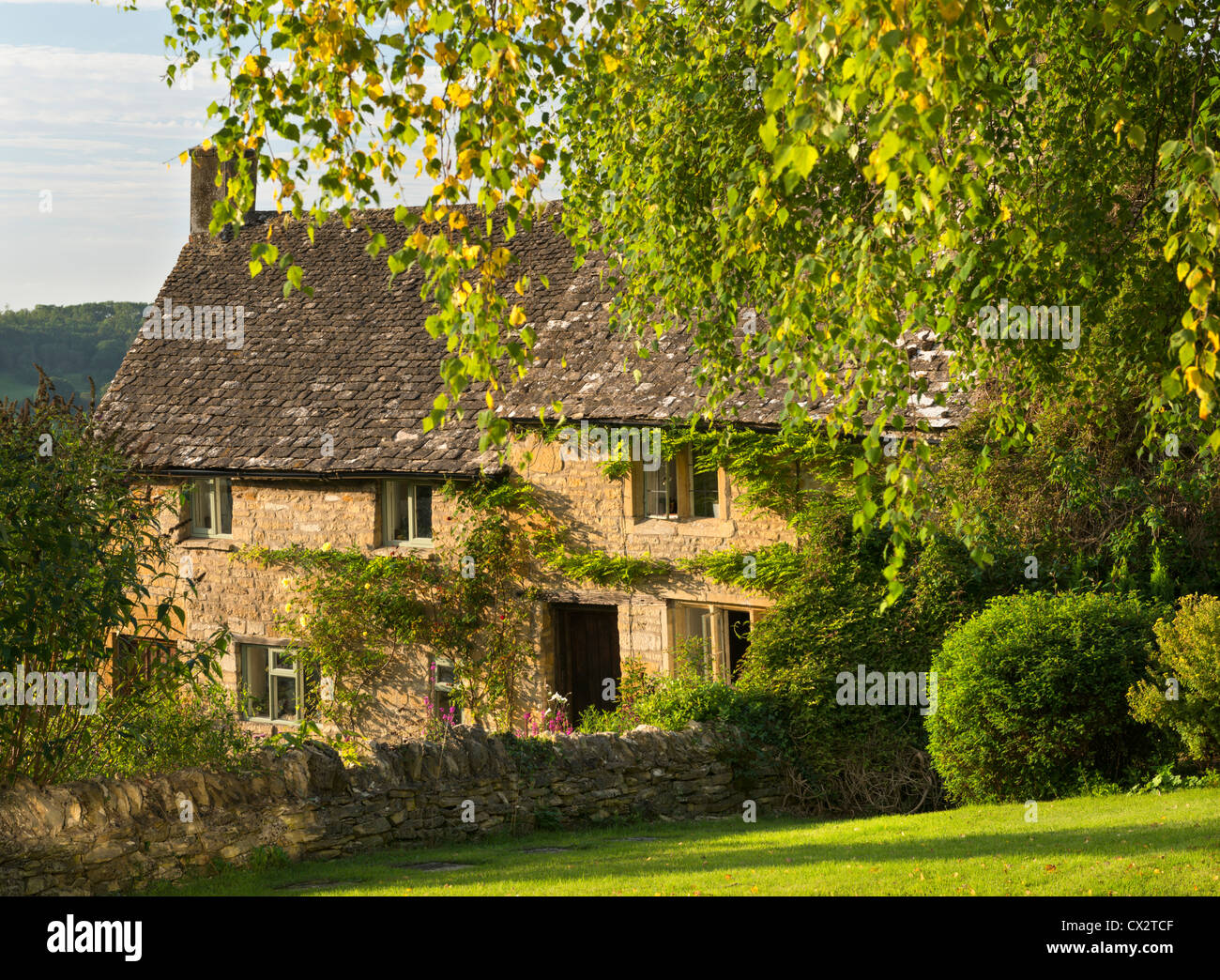 Pretty cottages in the Cotswolds village of Snowshill, Gloucestershire, England. September 2012. - Stock Image
