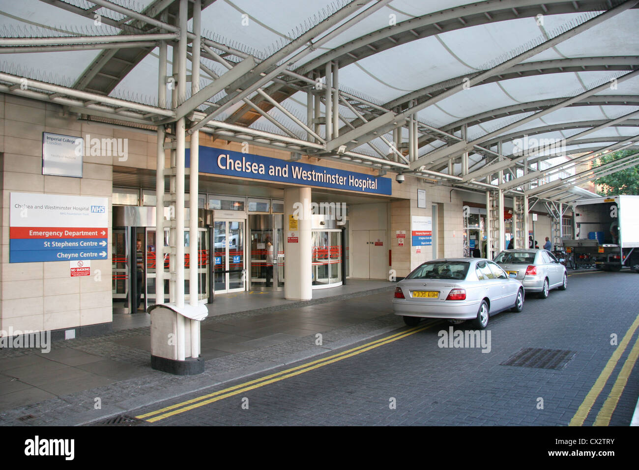 Cars parked at the entrance to Chelsea and Westminster Hospital, Fulham Rd, London SW10 9NH - Stock Image