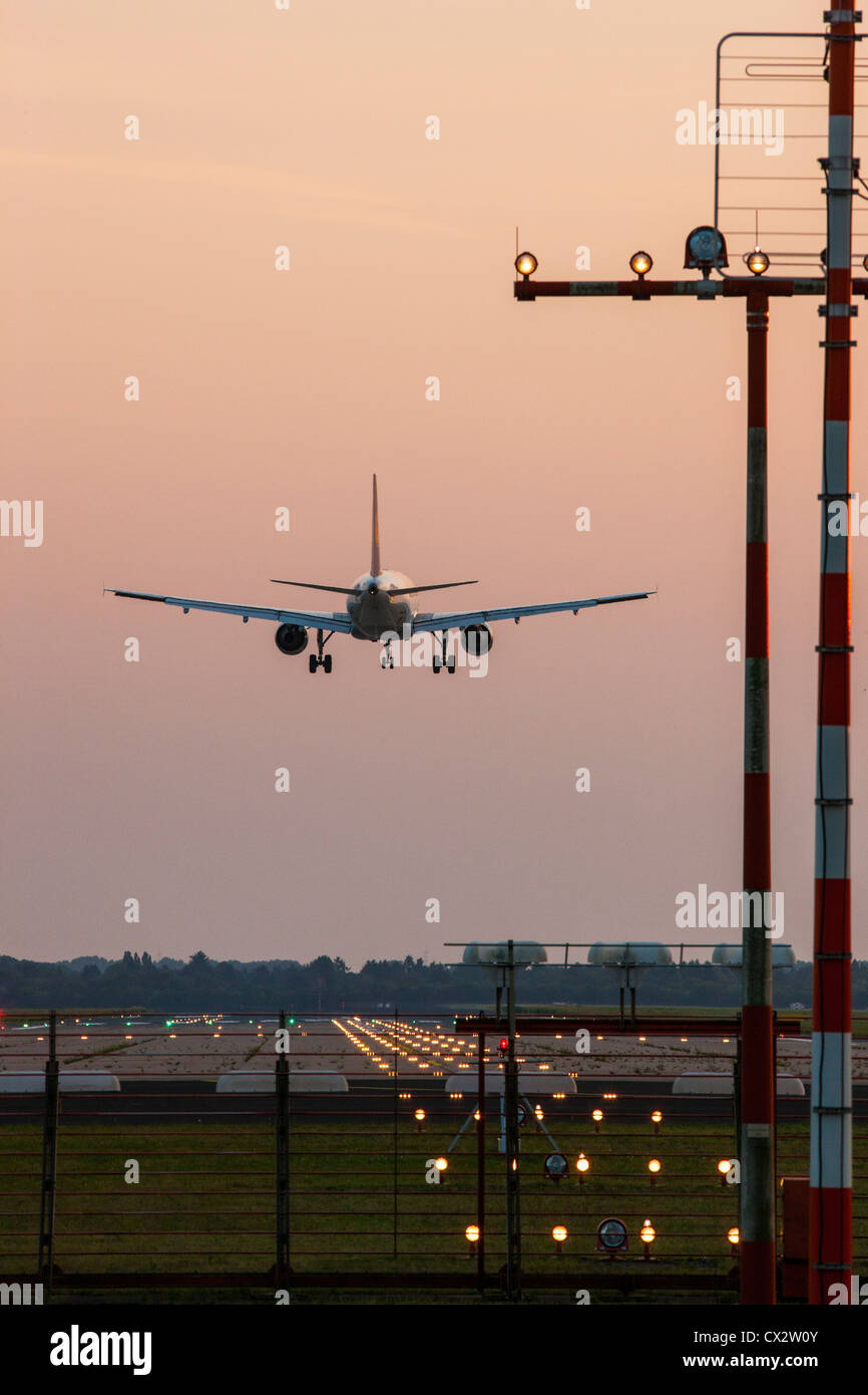 Passenger airplane approaching Düsseldorf International Airport. Germany. - Stock Image