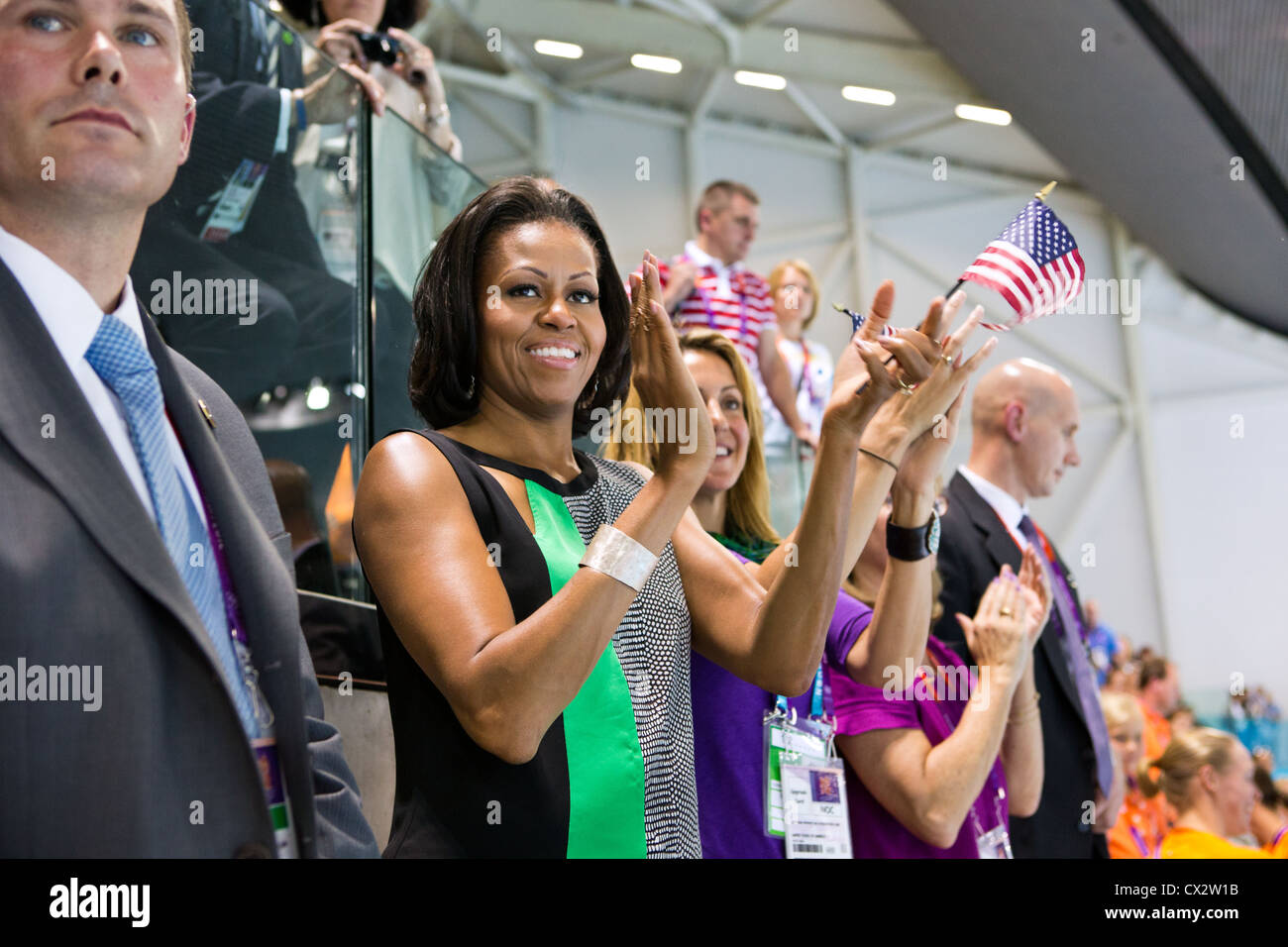 Michelle Obama watches the swimming finals and medal ceremonies at the Olympic Park Aquatics Center - Stock Image