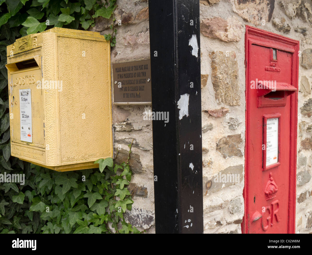 Town twinning concept illustrated by French and British postboxes in Braunton Devon, twinned with Plouescat in France. - Stock Image