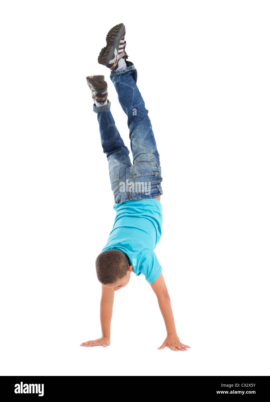 young boy handstand - Stock Image