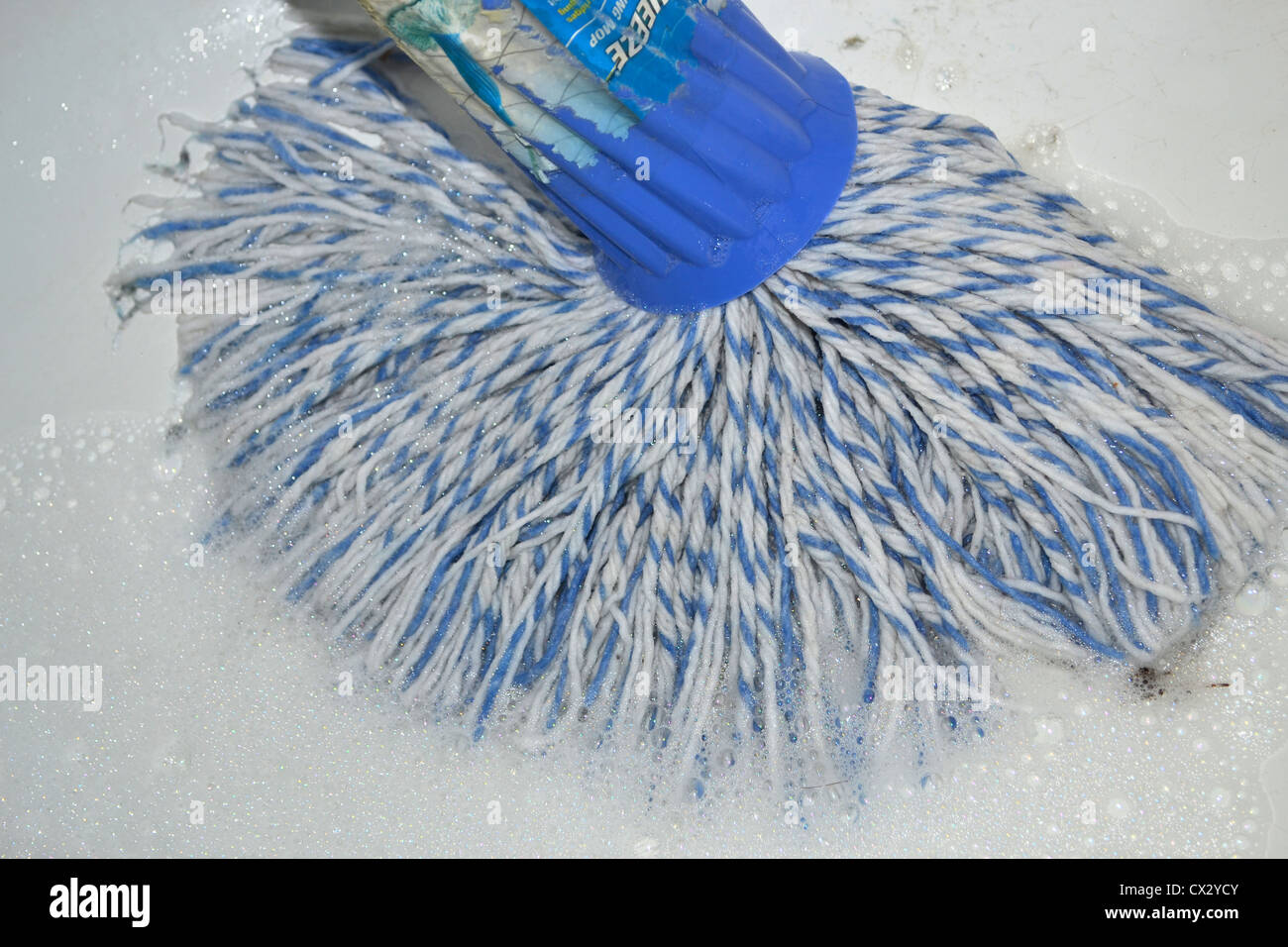 cleaning floor with a mop - Stock Image