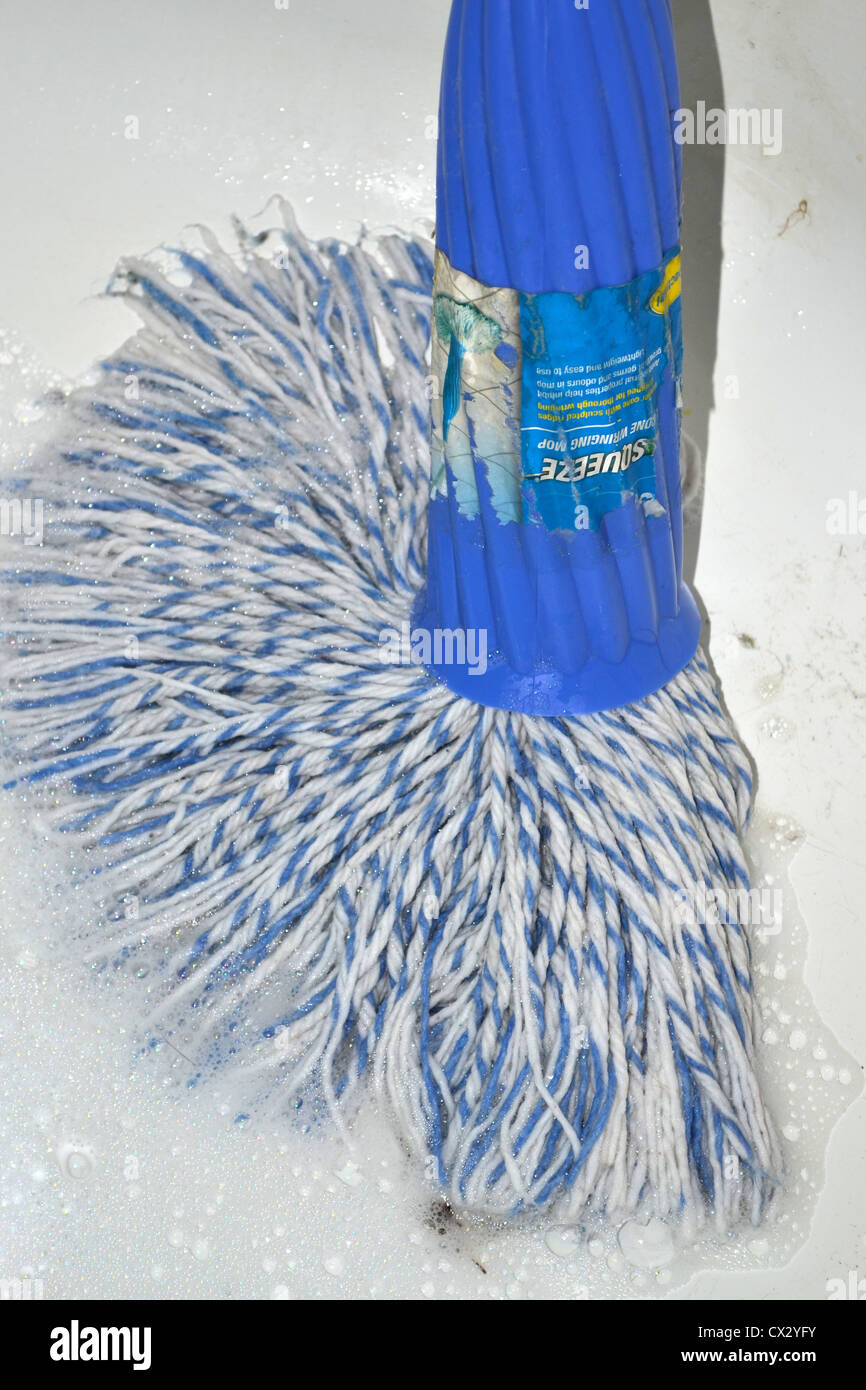 cleaning floor with a mop Stock Photo