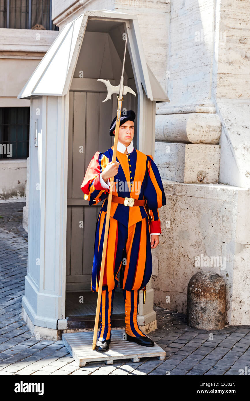 Swiss Guard on duty at a sentry box outside Saint Peter's Basilica, Vatican City, Rome, Italy. Stock Photo