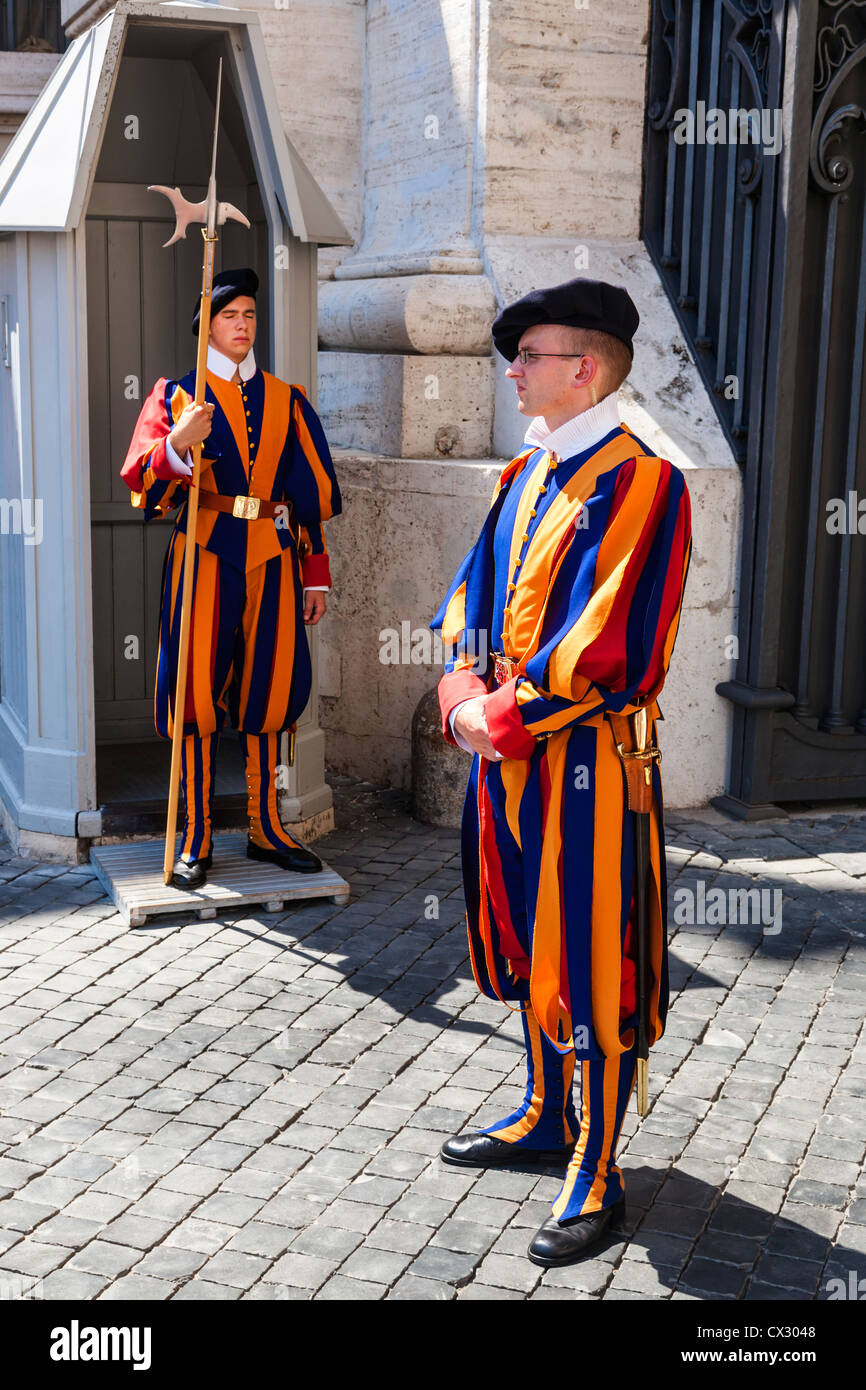 Swiss Guards on duty at a sentry box outside Saint Peter's Basilica, Vatican City, Rome, Italy. Stock Photo