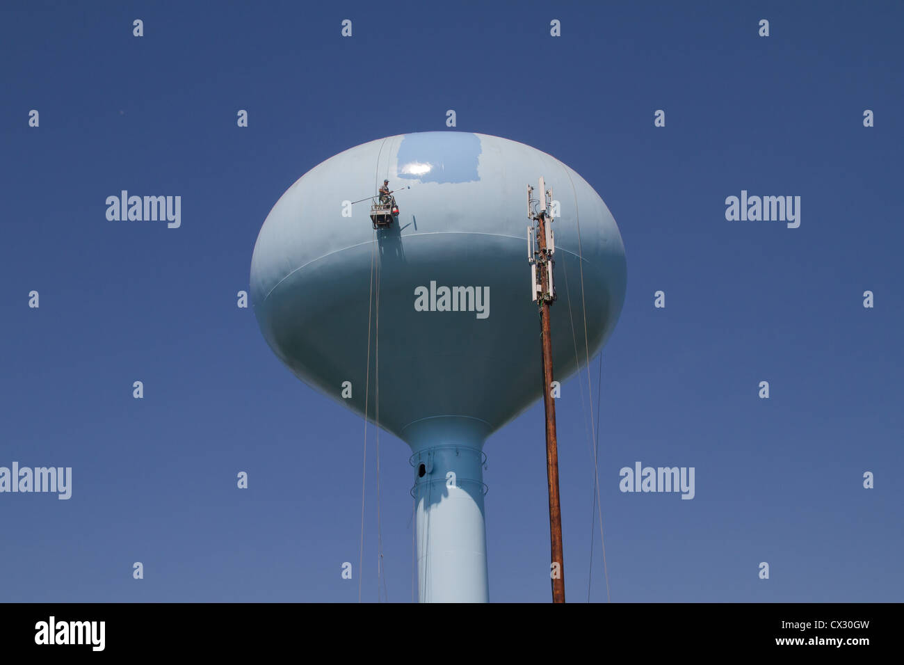 Water tower being repaired and painted - Stock Image