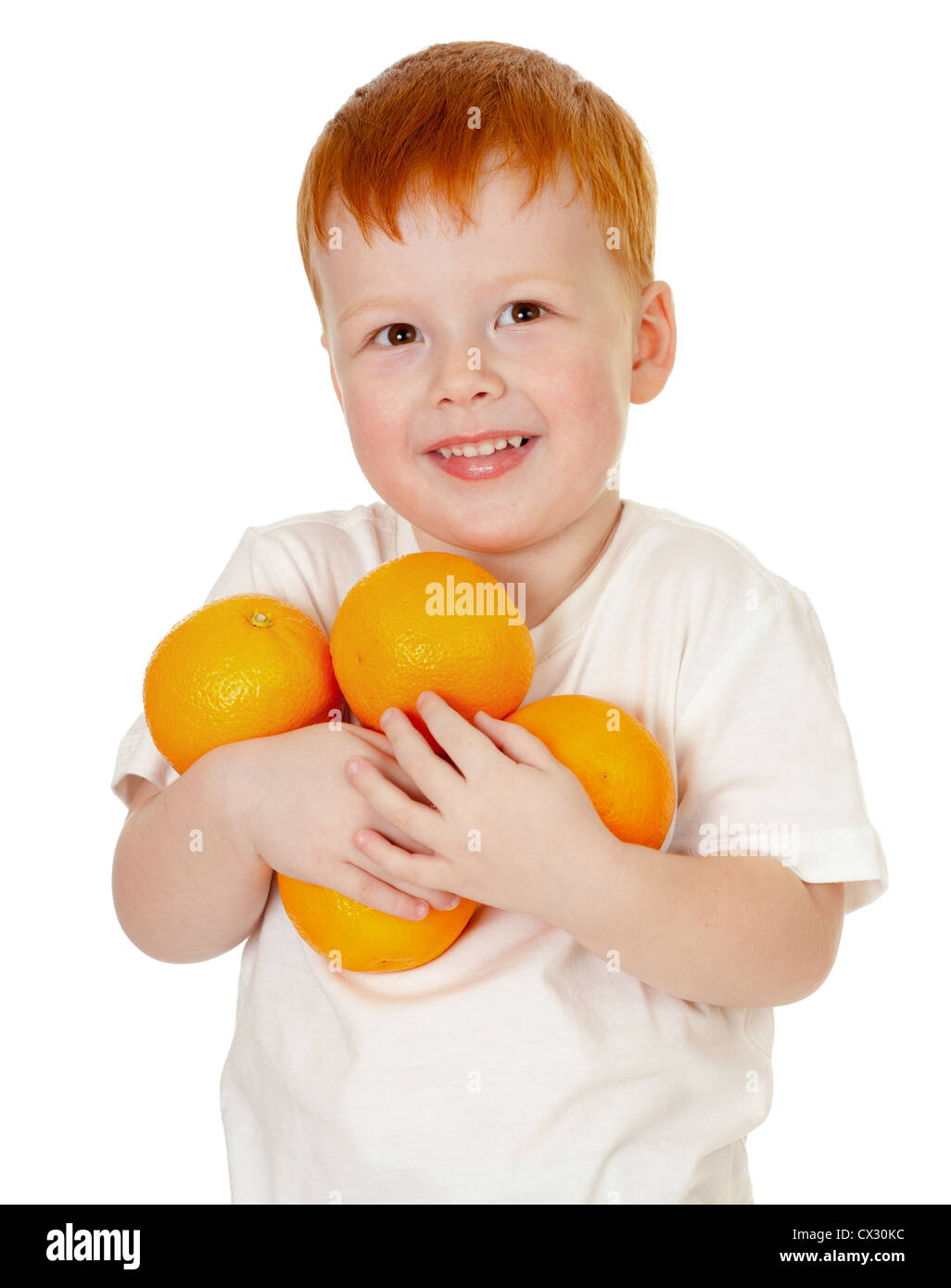 redheaded boy with oranges isolated on white - Stock Image