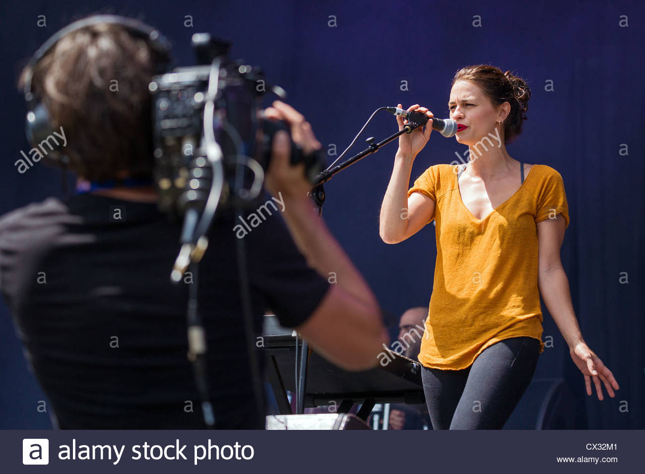 female singer performing live - Stock Image