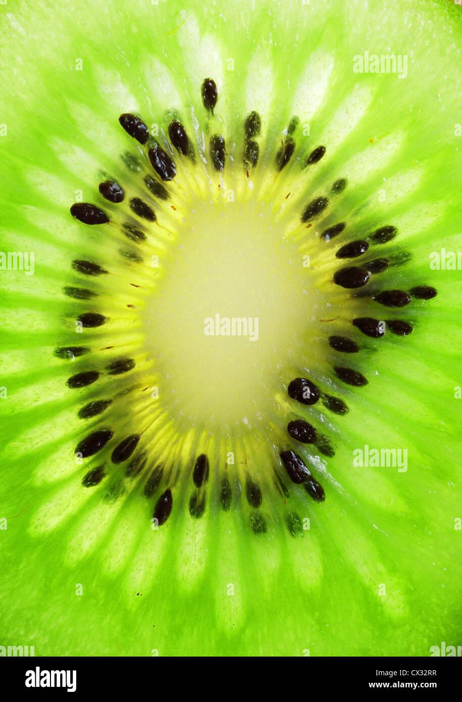 Close up of a slice of kiwi - Stock Image