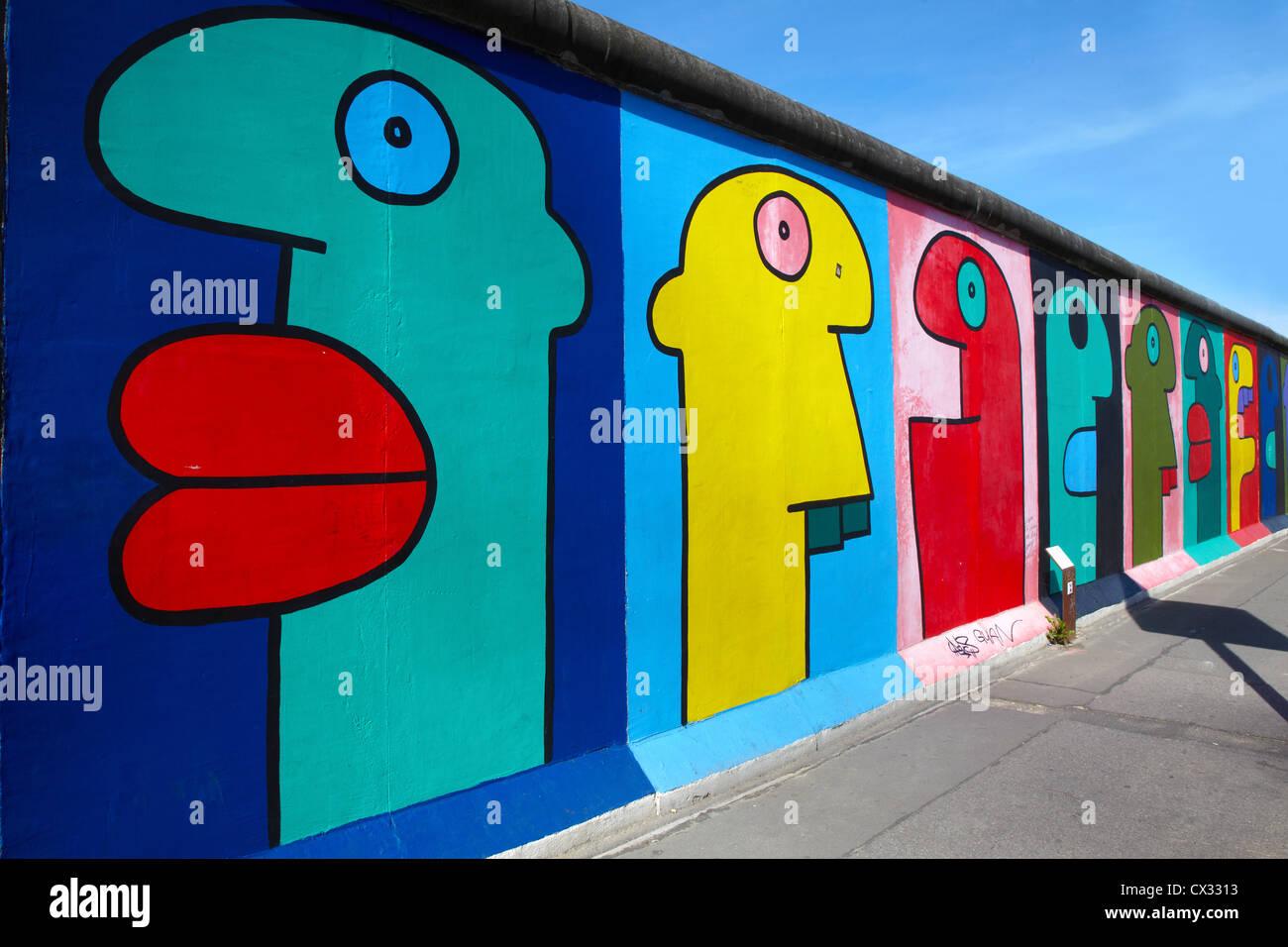 East side Gallery graffiti in Berlin - Stock Image