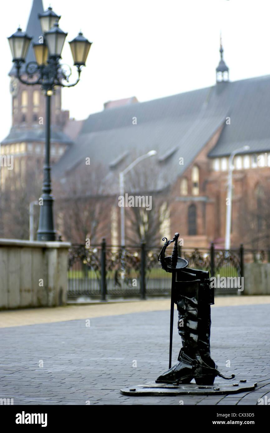 ITAR-TASS: KALININGRAD, RUSSIA. DECEMBER, 2011. High boot sculpture of Baron Karl Munchhausen in Rybnaya derevnya (Fishing village). (Photo ITAR-TASS/ Yelena Nagornykh) . . . -/ Stock Photo