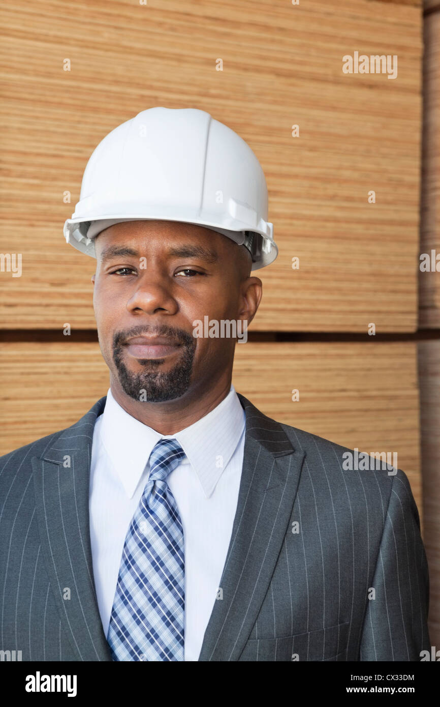Portrait of an African American male engineer with wooden planks in background Stock Photo