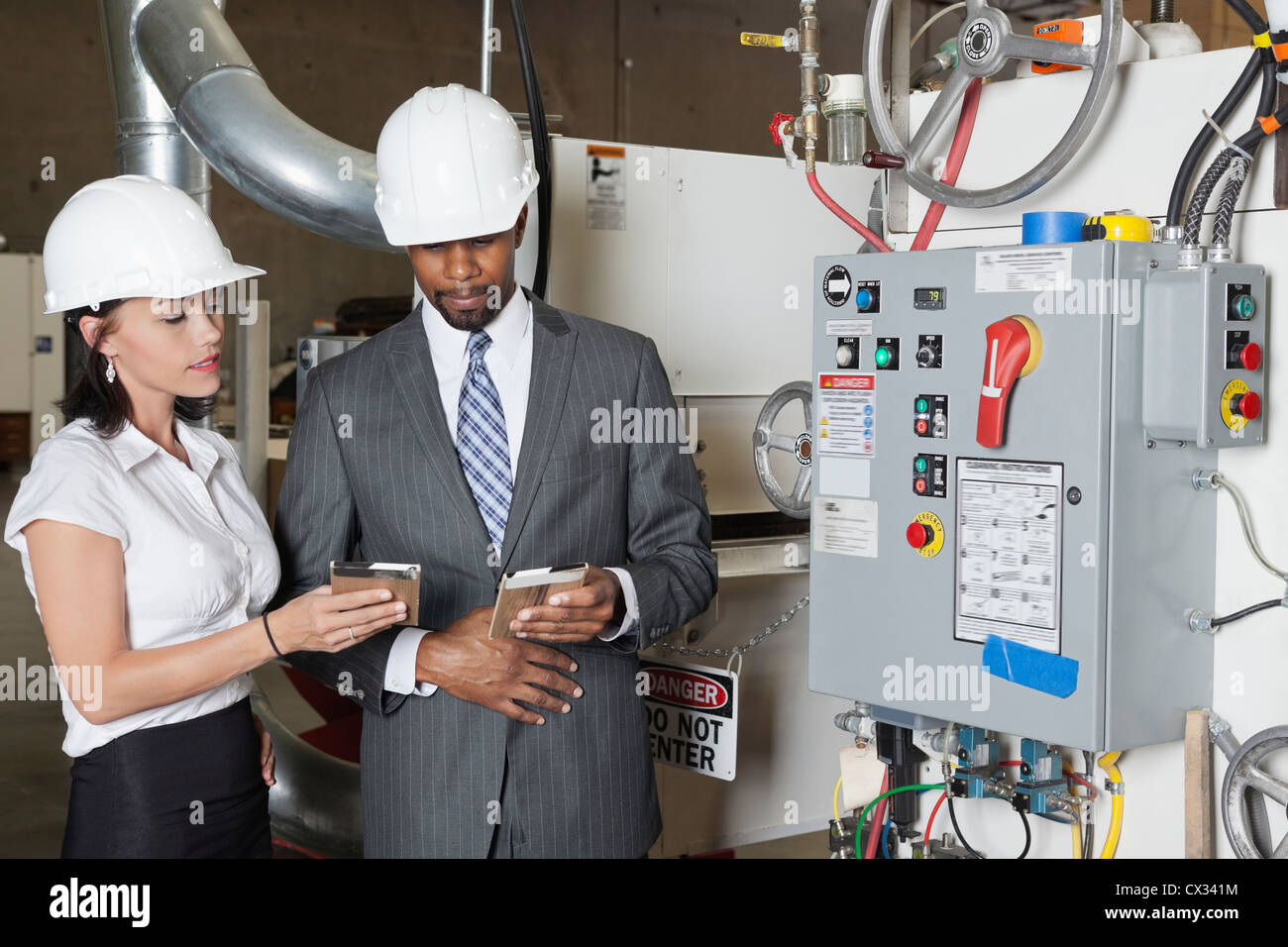 Building contractors in timber factory - Stock Image